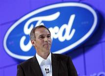 Roelant de Waard speaks at the launch of Ford's new environmentally friendly cars that run on bio ethanol fuel at the British International Motor Show in London July 18, 2006. REUTERS/Luke MacGregor