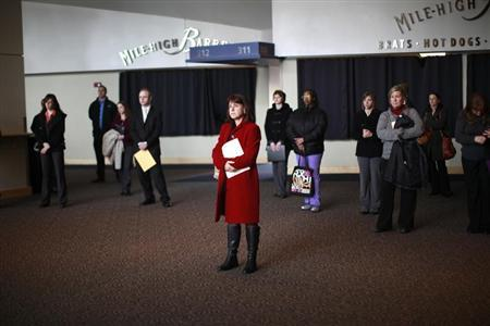 Job seekers listen to a presentation at the Colorado Hospital Association health care career fair in Denver April 9, 2013. REUTERS/Rick Wilking