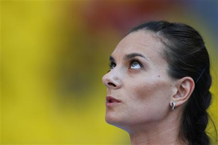Yelena Isinbayeva of Russia is pictured during the women's pole vault final at the IAAF World Athletics Championships at the Luzhniki stadium in Moscow August 13, 2013. REUTERS/Kai Pfaffenbach