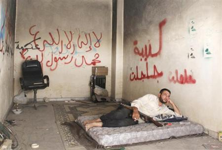A Free Syrian Army fighter rests inside a room in the Bab al-Nasr neighborhood of Aleppo August 14, 2013. REUTERS/Melhem Barakat