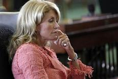 Texas state Democratic Senator Wendy Davis listens as the state Senate meets to consider legislation restricting abortion rights in Austin, Texas July 12, 2013 file photo. REUTERS/Mike Stone