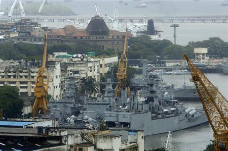 An elevated view shows the Indian Navy ships docked at the naval dockyard in Mumbai August 14, 2013. REUTERS/Vivek Prakash