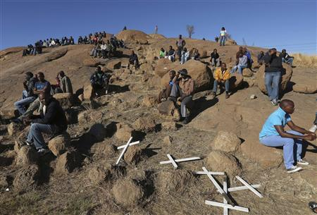 Crosses are placed at a hill known as the ''Hill of Horror'', during the one-year anniversary commemorations to mark the killings of 34 striking platinum miners shot dead by police outside the Lonmin's Marikana platinum mine in Rustenburg, 100 km (62 miles) northwest of Johannesburg, August 16, 2013. REUTERS/Siphiwe Sibeko