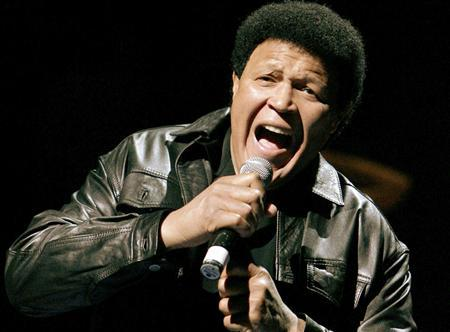 Rock legend Chubby Checker sings his trademark song ''The Twist'' at Denver Nuggets basketball game in Denver, Colorado, in this March 22, 2006 file photo. REUTERS/Rick Wilking/Files