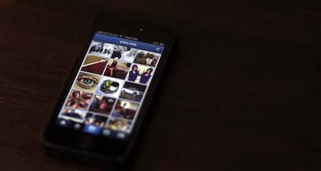 A most popular Instagram page is displayed on a mobile device screen in Pasadena, California August 14, 2013. REUTERS/Mario Anzuoni