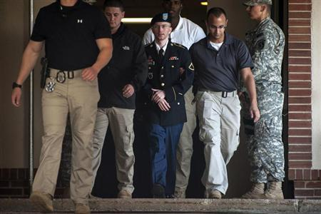 Private First Class Bradley Manning is escorted out of court after testifying in the sentencing phase of his military trial at Fort Meade, Maryland August 14, 2013. REUTERS/James Lawler Duggan