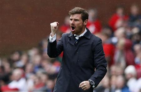 Tottenham Hotspur manager Andre Villas-Boas celebrates after Clint Dempsey scored against Stoke City during their English Premier League soccer match at the Britannia Stadium in Stoke-on-Trent, central England, May 12, 2013. REUTERS/Stefan Wermuth