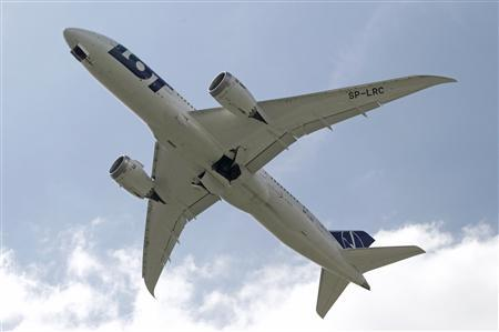 Boeing 787 Dreamliner belonging to Polish airline LOT flies after taking off from the Chopin International Airport in Warsaw June 1, 2013. REUTERS/Kacper Pempel