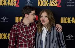 "Actors Christopher Mintz-Plasse and Chloe Grace Moretz (R) pose during a media event for the film ""Kick Ass 2"", in London August 5, 2013. REUTERS/Neil Hall"