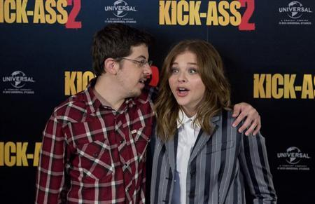 Actors Christopher Mintz-Plasse and Chloe Grace Moretz (R) pose during a media event for the film ''Kick Ass 2'', in London August 5, 2013. REUTERS/Neil Hall