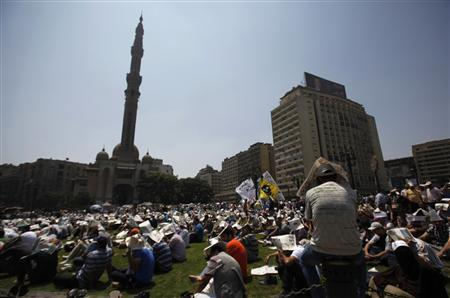 Members of the Muslim Brotherhood and supporters of ousted Egyptian President Mohamed Mursi attend Friday prayers at Ramses Square in Cairo August 16, 2013. REUTERS/Amr Abdallah Dalsh