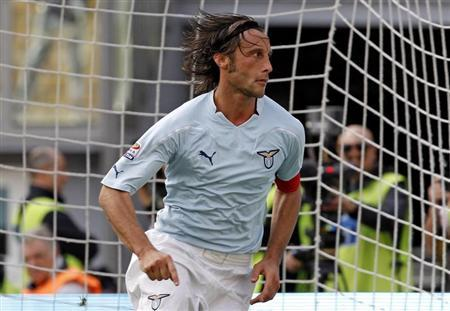 SS Lazio's Stefano Mauri celebrates after scoring against Cagliari during their Italian Serie A soccer match at the Olympic stadium in Rome October 24, 2010. REUTERS/Giampiero Sposito