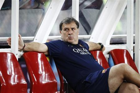 Barcelona's new coach Gerardo Martino rests after a training session ahead of their friendly soccer match against Malaysia XI in Kuala Lumpur August 9, 2013. REUTERS/Samsul Said