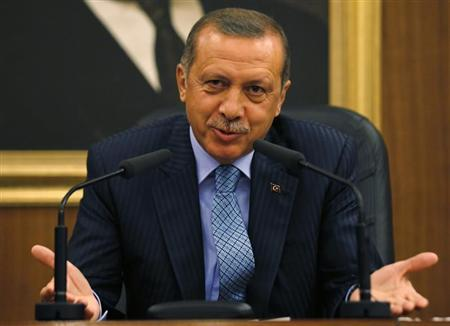 Turkey's Prime Minister Tayyip Erdogan gestures as he addresses the media before leaving for Turkmenistan at Esenboga Airport in Ankara August 15, 2013. REUTERS/Umit Bektas