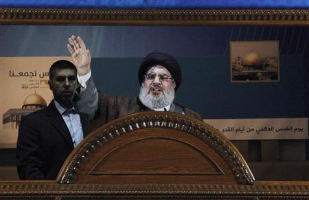 Lebanon's Hezbollah leader Sayyed Hassan Nasrallah makes a rare public appearance as he addresses his supporters during a rally to mark Quds (Jerusalem) Day in Beirut's southern suburbs, August 2, 2013. REUTERS/Sharif Karim