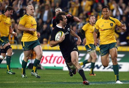 Australian Wallabies' Hugh McMeniman (L), Stephen Moore (2nd L) and Israel Folau (R) react as New Zealand All Blacks' Conrad Smith (front C) runs to score a try during their Bledisloe Cup rugby test match at Stadium Australia in Sydney August 17, 2013. REUTERS/David Gray