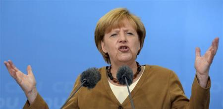 German Chancellor Angela Merkel (CDU) delivers her speech at an election campaign in Cloppenburg, August 17, 2013. REUTERS/Fabian Bimmer