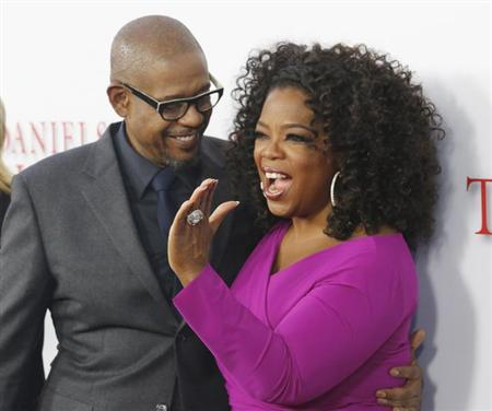 Actors Oprah Winfrey and Forest Whittaker, cast members of the film ''Lee Daniels' The Butler'', pose at the film's premiere in Los Angeles August 12, 2013. REUTERS/Fred Prouser