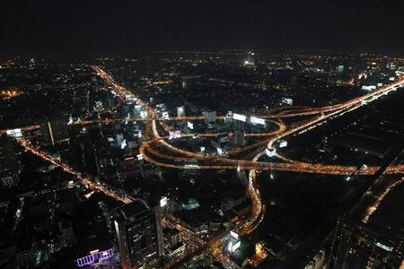 A view from a tall building shows traffic moving on highways in Bangkok March 6, 2013. REUTERS/Chaiwat Subprasom