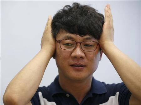 North Korean defector Kim, who only gave his surname of Kim for fear of reprisals against his family in North Korea, gestures during an interview with Reuters in Seoul August 5, 2013. REUTERS/Kim Hong-Ji
