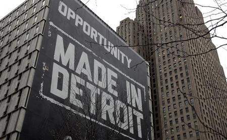A large ''Opportunity Made In Detroit'' banner is seen on the side of one of the buildings owned by Quicken Loans founder Dan Gilbert in downtown Detroit, Michigan January 30, 2013. REUTERS/Rebecca Cook