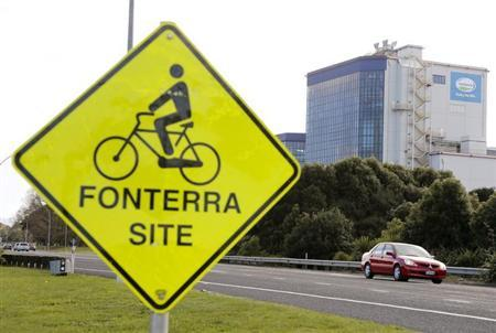 The Fonterra Te Rapa plant is seen behind a sign board for cyclists near Hamilton, August 6, 2013. REUTERS/Nigel Marple