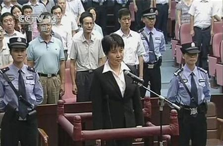 Gu Kailai (C), wife of ousted Chinese Communist Party Politburo member Bo Xilai, stands at the defendant's dock during a trial in the court room at Hefei Intermediate People's Court in this still image taken from video August 20, 2012. REUTERS/CCTV via Reuters TV