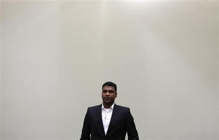 Bayern Munich defender Breno arrives in a court room in Munich June 13, 2012. REUTERS/Michaela Rehle/Files