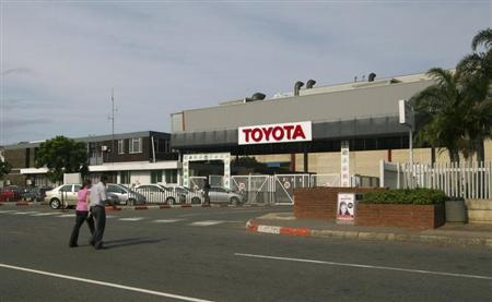 People walk near Toyota Motor Corp's Durban car factory, which has been forced to shut down for four days due to an illegal pay strike by employees, in Durban October 4, 2012, the first sign of wildcat mine stoppages spreading into other parts of Africa's biggest economy. REUTERS/Rogan Ward