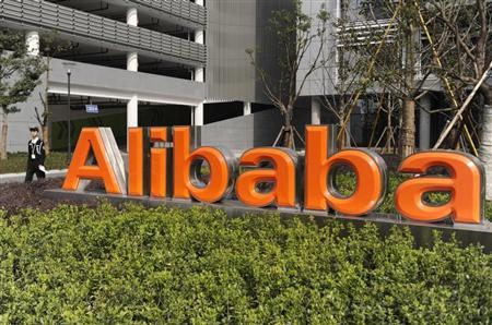 A security guard walks past a logo of Alibaba (China) Technology Co. Ltd at its headquarters on the outskirts of Hangzhou, Zhejiang province March 16, 2010. REUTERS/Lang Lang