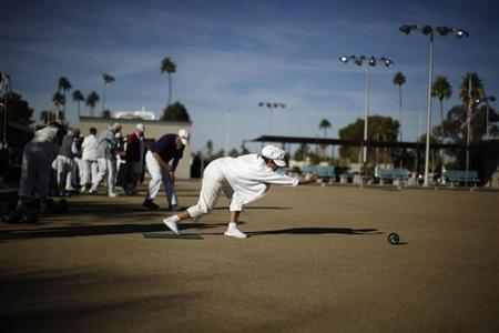 A senior citizen lawn bowls in Sun City, Arizona, January 9, 2013. REUTERS/Lucy Nicholson