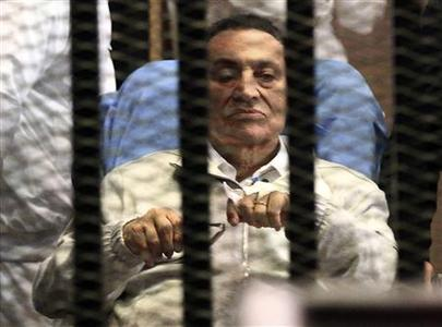 Egypt's ousted President Hosni Mubarak sits inside a dock at the police academy on the outskirts of Cairo, in this file picture taken April 15, 2013. REUTERS-Stringer-Files