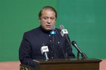 Pakistan's Prime Minister Nawaz Sharif addresses attendees at a flag raising ceremony to mark the country's 67th Independence Day in Islamabad August 14, 2013. REUTERS/Mian Khursheed/Files