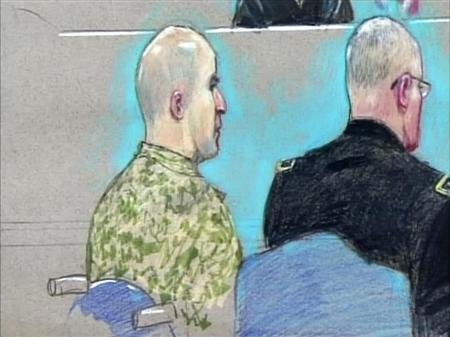U.S. Army Major Nidal Malik Hasan (L) appears before the Fort Hood Chief Circuit Judge Colonel Gregory Gross with a military lawyer (R) during an arraignment as seen in this courtroom sketch, July 20, 2011. REUTERS/Pat Lopez/Pool