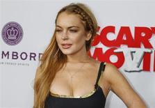 """Imagen de archivo de la actriz Lindsay Lohan durante una premiere en Hollywood. REUTERS/Fred Prouser. Semanas después de terminar su sexto viaje de rehabilitación, la actriz Lindsay Lohan dijo en una entrevista televisiva que es una adicta y que se ha dado cuenta de que necesita """"callarse y escuchar"""" porque su intento de tratar sus problemas personales no ha funcionado."""