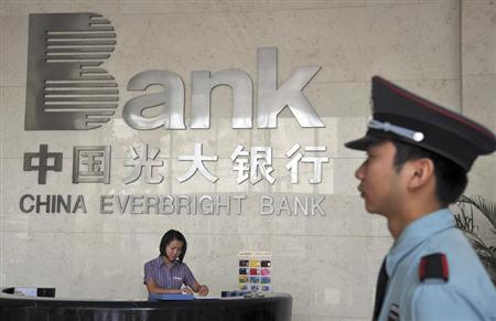 A security personnel on duty stands next to the reception desk at a branch of China Everbright Bank in Hefei, Anhui province August 18, 2010. REUTERS/Stringer