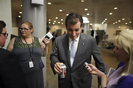 U.S. Senator Ted Cruz (R-TX) (C) talks with a reporter after the weekly Republican caucus luncheon at the U.S. Capitol in Washington, June 25, 2013. REUTERS/Jonathan Ernst