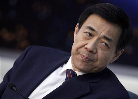 Then Chongqing Municipality Communist Party Secretary Bo Xilai listens to Chongqing's Mayor Huang Qifan (not pictured) during a meeting at the annual session of China's parliament, the National People's Congress, at the Great Hall of the People in Beijing, in this March 6, 2010 file photo. REUTERS/Jason Lee/Files