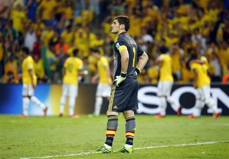 Spain's goalkeeper Iker Casillas reacts after Brazil scored their third goal during their Confederations Cup final soccer match at the Estadio Maracana in Rio de Janeiro June 30, 2013. REUTERS/Kai Pfaffenbach