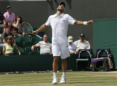 Viktor Troicki of Serbia reacts after losing advantage in his men's singles tennis match against Mikhail Youzhny of Russia at the Wimbledon Tennis Championships, in London June 29, 2013. REUTERS/Suzanne Plunkett
