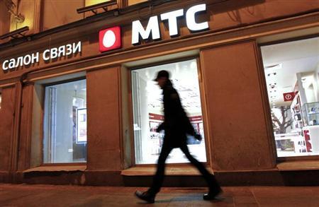 A man walks past a MTS shop in St.Petersburg March 18, 2013. REUTERS/Alexander Demianchuk