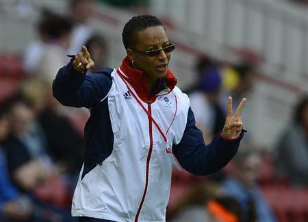 Team GB's coach Hope Powell gestures during their Olympic women's friendly soccer game against Sweden ahead of the London 2012 Olympic Games at the Riverside Stadium in Middlesbrough, northern England, July 20, 2012. REUTERS/Nigel Roddis