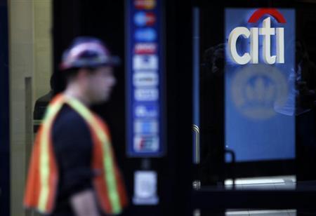 A man walks past a Citibank branch in lower Manhattan, New York October 16, 2012. REUTERS/Carlo Allegri