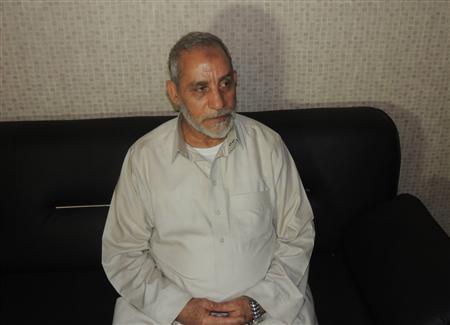 Muslim Brotherhood leader Mohamed Badie sits at a police station after being arrested by security forces in Cairo, in this Egyptian Interior Ministry handout picture provided on August 20, 2013. REUTERS/Egyptian Interior Ministry/Handout