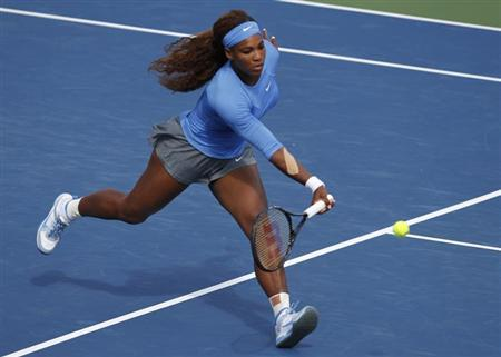Serena Williams of the U.S. hits a return to Victoria Azarenka of Belarus during their championship match at the women's Cincinnati Open tennis tournament in Cincinnati, Ohio August 18, 2013. REUTERS/John Sommers II