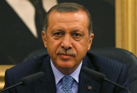 Turkey's Prime Minister Tayyip Erdogan addresses the media before he leaves for Turkmenistan at Esenboga Airport in Ankara August 15, 2013. REUTERS/Umit Bektas
