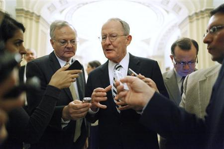 U.S. Senator Lamar Alexander (R-TN) (C) talks with reporters following the weekly Republican caucus luncheon at the U.S. Capitol in Washington June 18, 2013. REUTERS/Jonathan Ernst