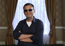 """Chinese director Kar Wai Wong poses for a portrait while promoting his upcoming movie """"The Grandmaster"""" in Los Angeles, California in this July 23, 2013 file photo. REUTERS/Mario Anzuoni/Files"""