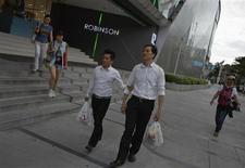 Pattanachat Monkhatha (L) and Vitaya Saeng-Aroon (R) leave a department store in Bangkok August 16, 2013. The couple have been together for 5 years. REUTERS/Athit Perawongmetha