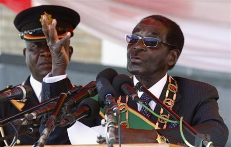 Zimbabwe's President Robert Mugabe addresses the crowd gathered to commemorate Heroes Day in Harare August 12, 2013. REUTERS/Philimon Bulawayo